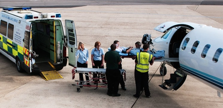 Medical Crew loading a patient into an air ambulance.